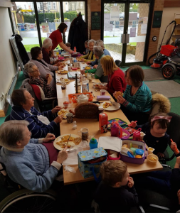 Toddlers and older people meet up for a workshop in Builth Wells arranged by Cymryd Rhan